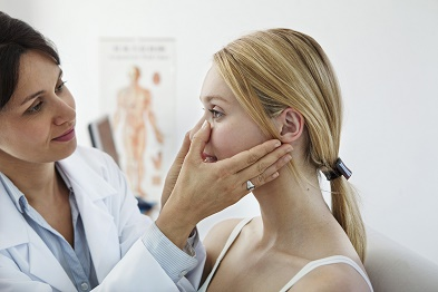 Doctor Checking Nose
