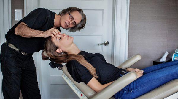 Dr.Oakley Smith Examining Patient